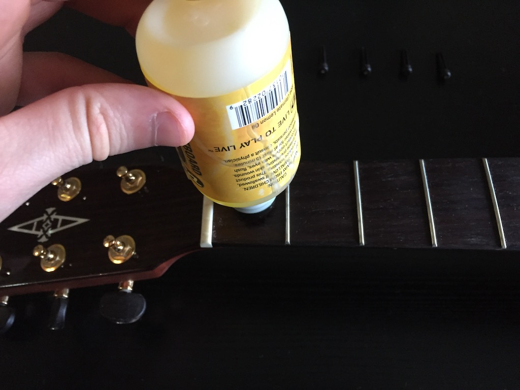 applying fretboard cleaner