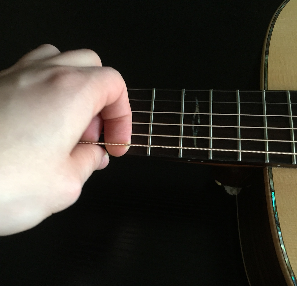 stretching guitar strings