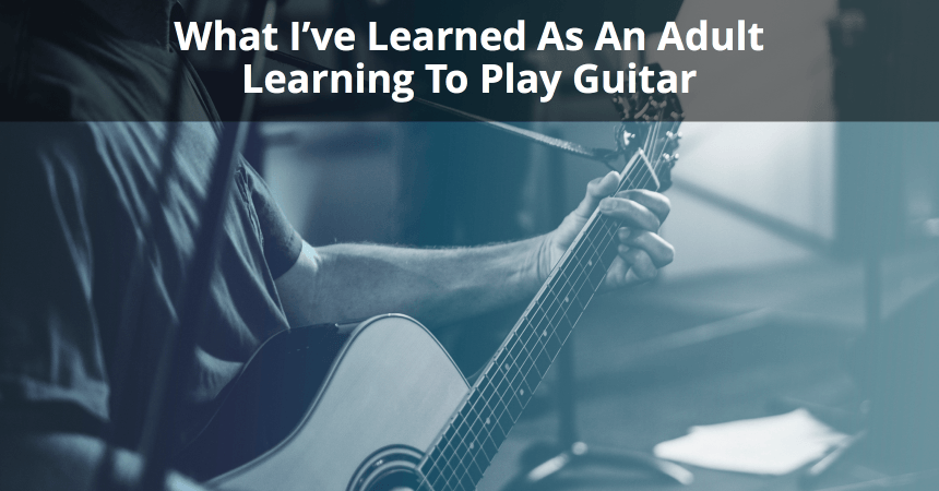 adult learning to play guitar